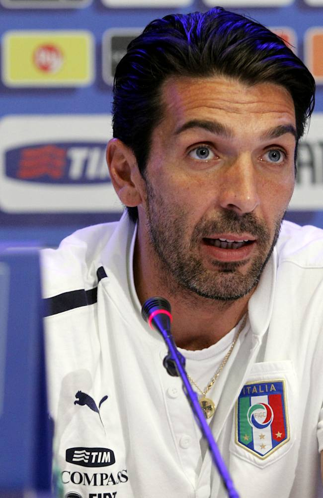 Italian national soccer team goalie Gianluigi Buffon, of F.C. Juventus, speaks at a press conference after a training session with the team at the Coverciano sports center, near Florence, central Italy, Wednesday, Oct. 9, 2013, ahead of a 2014 FIFA World Cup, Group B, qualification match against Denmark in Copenhagen on Friday. Other teams in Group B are, Armenia, Bulgaria, Czech Republic, and Malta