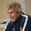 Manchester City Football Club manager Manuel Pellegrini laughs during a news conference in New York, Tuesday, July 29, 2014, in advance of Wednesday's Guinness International Champions Cup soccer match against rival Liverpool