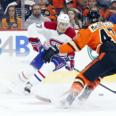 Montreal Canadiens' Rene Bourque, left, looks to make his move with the puck against Philadelphia Flyers' Andrew MacDonald, right, during the first period of an NHL hockey game, Saturday, Oct. 11, 2014, in Philadelphia The Associated Press
