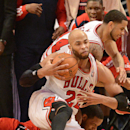 Chicago Bulls forward Taj Gibson (22) goes to the ground in a scramble for the ball during Game 2 in an opening-round NBA basketball playoff series Tuesday, April 22, 2014, in Chicago. The Wizards won 101-99 The Associated Press