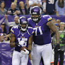 Minnesota Vikings wide receiver Greg Jennings, left, celebrates with teammate Phil Loadholt after catching an 8-yard touchdown pass during the second half of an NFL football game against the Chicago Bears, Sunday, Dec. 1, 2013, in Minneapolis The Associat