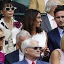England and Chelsea soccer player Frank Lampard, right, and his girlfriend Christine Bleakley, left of him, sit in the Royal Box on centre court prior to the women's singles final between Eugenie Bouchard of Canada and Petra Kvitova of the Czech Republic