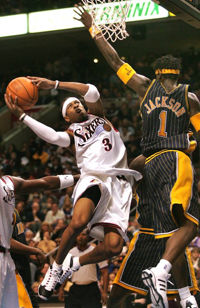 In this Nov. 12, 2004, file photo, Philadelphia 76ers' Allen Iverson, left, tries to get around Indiana Pacers' Stephen Jackson for a shot during the second half  in Philadelphia. Iverson officially retired from the NBA on Wednesday, Oct. 30, 2013, ending a 15-year career during which he won the 2001 MVP award and four scoring titles