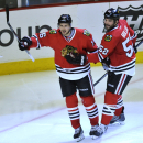 Chicago Blackhawks' Marcus Kruger (16), celebrates with teammate Brandon Bollig (52), after scoring during the third period of an NHL hockey game against the St. Louis Blues in Chicago, Wednesday, March, 19, 2014. Chicago won 4-0 The Associated Press