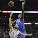 San Antonio Spurs' Tony Parker tries to make an off-balance shot as Dallas Mavericks' DeJuan Blair (45) defends during the first half of an NBA basketball game, Sunday, March 2, 2014, in San Antonio The Associated Press