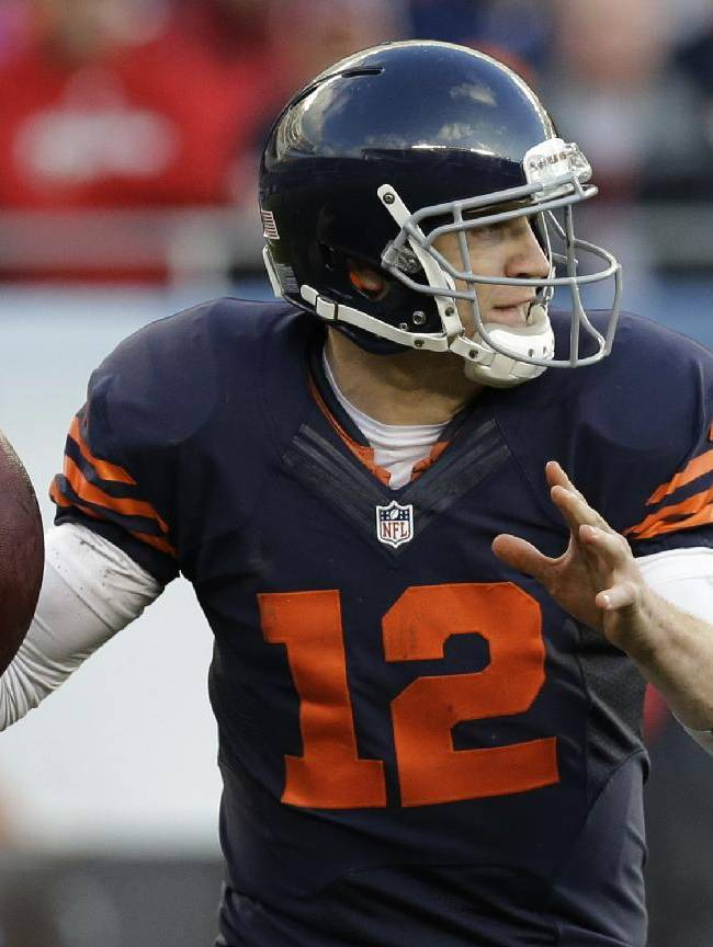 Chicago Bears quarterback Josh McCown (12) looks to throw a pass against the Baltimore Ravens during the first half of an NFL football game Sunday, Nov. 17, 2013, in Chicago