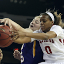 Alabama guard Daisha Simmons (0) and LSU forward Theresa Plaisance reach for the ball in the second half of a second-round women's Southeastern Conference tournament NCAA college basketball game Thursday, March 6, 2014, in Duluth, Ga. (AP Photo/Jason Getz)