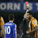 Hull's Tom Huddlestone, right is shown a red card by referee Chris Foy during their English Premier League soccer match between Chelsea and Hull City at Stamford Bridge stadium in London, Saturday, Dec 13, 2014