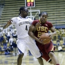 Southern California's Brianna Barrett (23) dribbles next to California 's Eliza Pierre (4) during the first half of an NCAA college basketball game in Berkeley, Calif., Thursday, Jan. 17, 2013. (AP Photo/Marcio Jose Sanchez)