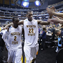 Wichita State's Malcolm Armstead (2) and Carl Hall walk off court following their team's 72-58 victory over La Salle in their West Regional semifinal in the NCAA college basketball tournament, Thursday, March 28, 2013, in Los Angeles. (AP Photo/Jae C. Hong)