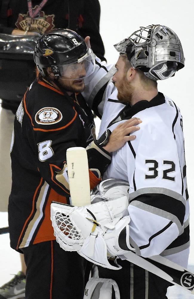Los Angeles Kings goalie Jonathan Quick, right, is congratulated by Anaheim Ducks right wing Teemu Selanne, of Finland, after the Ducks were defeated by the Kings in Game 7 of an NHL hockey second-round Stanley Cup playoff series, Friday, May 16, 2014, in Anaheim, Calif. The Kings won 6-2