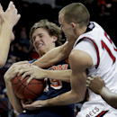 Pepperdine's Jett Raines, left, fights for a rebound against Saint Mary's Beau Levesque in the second half of a quarterfinal West Coast Conference NCAA college basketball tournament game, Saturday, March 8, 2014, in Las Vegas The Associated Press