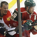 Florida Panthers' Tomas Kopecky loses his helmet in the corner near Minnesota Wild's Ryan Suter (20) during the third period of an NHL hockey game on Friday, Nov. 15, 2013, in St. Paul, Minn The Associated Press