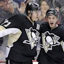 Pittsburgh Penguins' Evgeni Malkin, left, celebrates his second-period goal with Jayson Megna (59) during an NHL hockey game against the Columbus Blue Jackets in Pittsburgh, Monday, Dec. 9, 2013. (AP Photo/Gene J. Puskar)