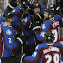 From left, Colorado Avalanche defensemen Nick Holden and Erik Johnson, left wing Gabriel Landeskog, of Sweden, and centers Ryan O'Reilly and Nathan MacKinnon celebrate after Landeskog's power-play goal against the Florida Panthers in the second period of
