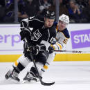 Los Angeles Kings left wing Kyle Clifford, left, battles for the puck with Buffalo Sabres defenseman Andre Benoit during the first period of an NHL hockey game, Thursday, Oct. 23, 2014, in Los Angeles. (AP Photo/Mark J. Terrill)