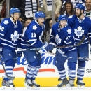 Toronto Maple Leafs' Stuart Percy (50), Joffrey Lupul (19), Brandon Kozun (67) and Troy Bodie celebrate after scoring against the Montreal Canadiens during first-period NHL hockey game action in Toronto, Wednesday, Oct. 8, 2014 The Associated Press