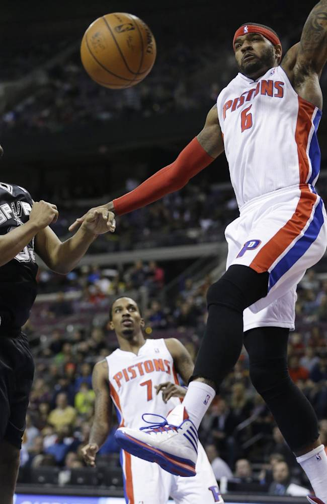 Detroit Pistons forward Josh Smith (6) reacts after a dunk on San Antonio Spurs forward Boris Diaw (33) during the second half of an NBA basketball game in Auburn Hills, Mich., Monday, Feb. 10, 2014