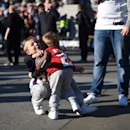 Young football fans play with a ball during the NFL Fan Rally in Trafalgar Square, London, Saturday, Oct. 25, 2014. The Atlanta Falcons will play the Detroit Lions in an NFL football game at London's Wembley Stadium on Sunday Oct. 26 The Associated Press