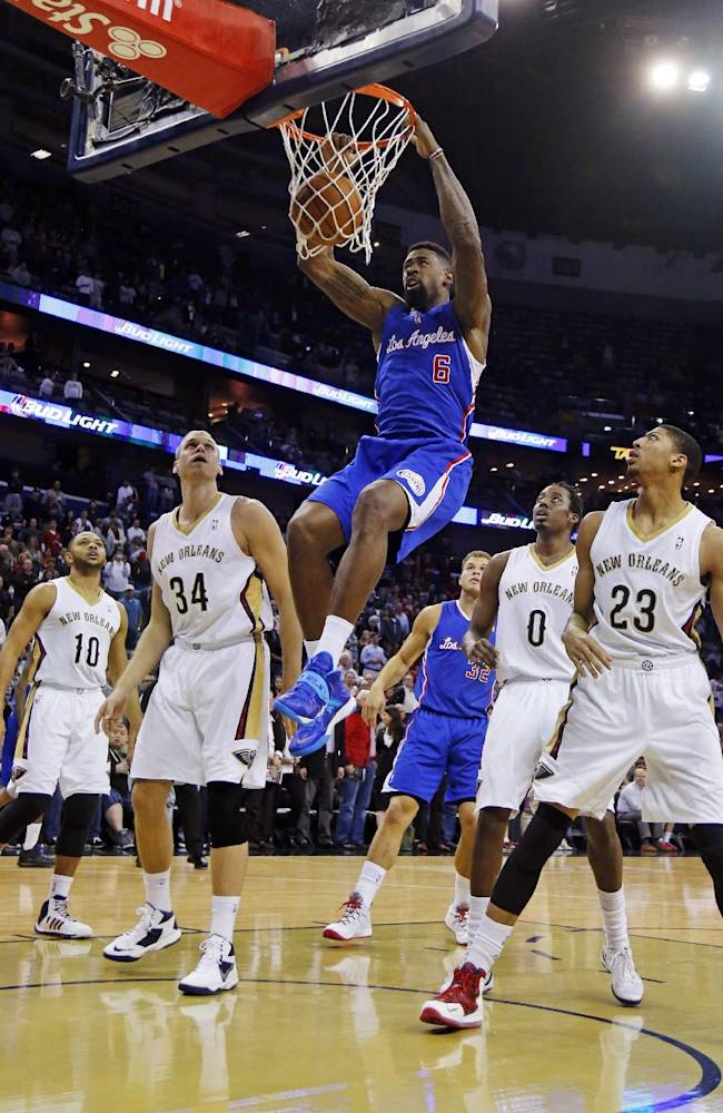 Los Angeles Clippers center DeAndre Jordan (6) dunks the ball over New Orleans Pelicans's Eric Gordon (10), Greg Stiemsma (34), Al-Farouq Aminu (0)  and Anthony Davis (23) in the first half of an NBA basketball in New Orleans, Monday, Feb. 24, 2014