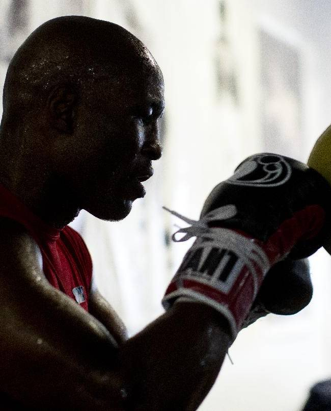 Boxer Bernard Hopkins hits a bag during a media workout Wednesday, Oct. 16, 2013, in Philadelphia. Hopkins is scheduled to fight Karo Murat at Boardwalk Hall in Atlantic City, N.J., on Oct. 26