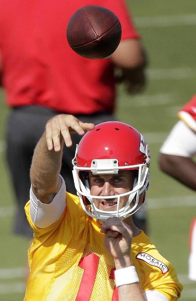 Kansas City Chiefs quarterback Alex Smith (11) throws during NFL football training camp Thursday, July 24, 2014, in St. Joseph, Mo