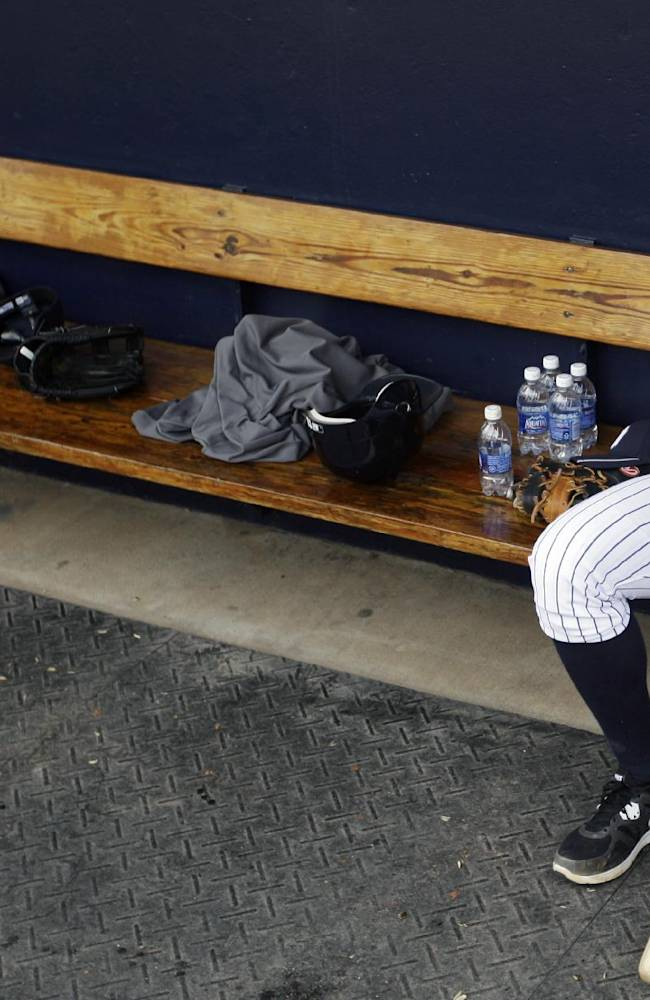 In this Feb. 25, 2012, file photo, New York Yankees' Alex Rodriguez sits in the dugout during practice at baseball spring training in Tampa, Fla.  Rodriguez gets to start arguing his case Monday, Sept. 30, 2013. In a hearing room before arbitrator Fredric Horowitz, lawyers for  Rodriguez will argue why the 211-game suspension imposed by Major League Baseball on Aug. 5 should be overturned