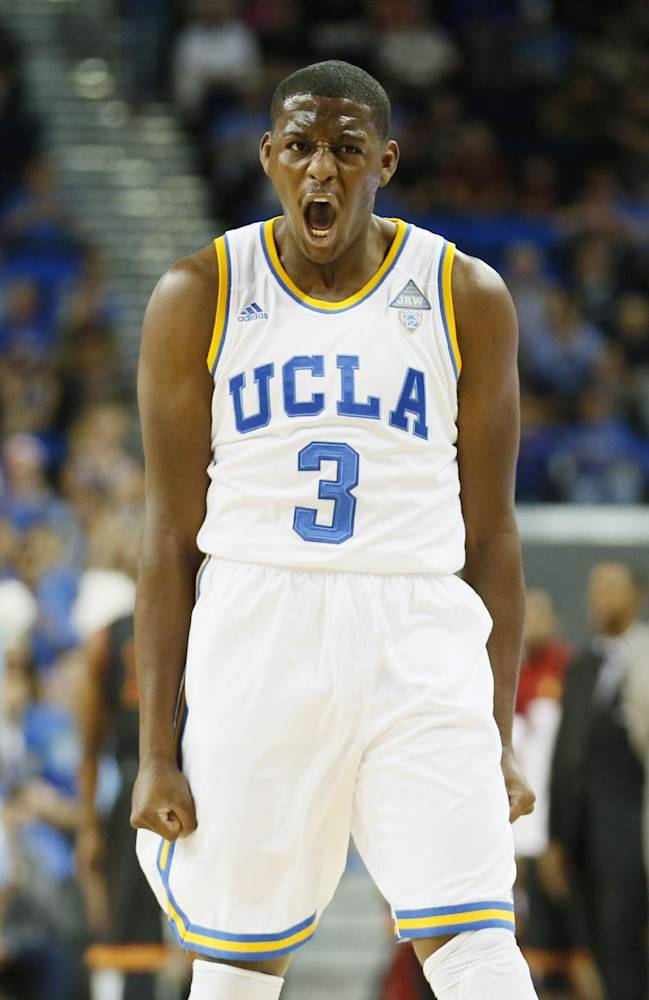 UCLA's Jordan Adams celebrates after scoring a three-point basket against Southern California during the first half of an NCAA college basketball game on Sunday, Jan. 5, 2014, in Los Angeles