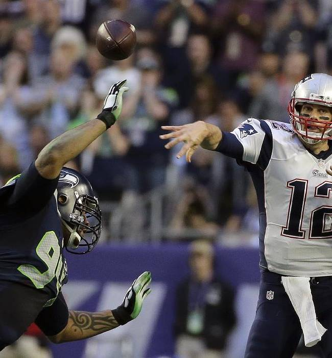 New England Patriots quarterback Tom Brady (12) throws a pass as Seattle Seahawks defensive tackle Kevin Williams (94) pressures during the first half of NFL Super Bowl XLIX football game Sunday, Feb. 1, 2015, in Glendale, Ariz