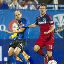 Montreal Impact's Justin Mapp, left, and Chicago Fire's Greg Cochrane battle for the ball during the second half of an MLS soccer game Saturday, Aug. 16, 2014, in Montreal The Associated Press