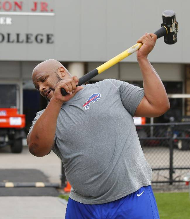 Buffalo Bills tackle Alan Branch works out on the sidelines during the opening night of their NFL football training camp in Pittsford, N.Y., Sunday, July 20, 2014