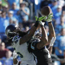 FILE - In this Oct. 26, 2014, file photo, Carolina Panthers wide receiver Kelvin Benjamin (13), right, makes a catch against Seattle Seahawks cornerback Richard Sherman (25), left, and Earl Thomas (obscured) during the second half of an NFL football game in Charlotte. Benjamin has compiled an impressive resume with the Panthers. (AP Photo/Chuck Burton, File)