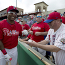 Philadelphia Phillies' Marlon Byrd smiles as he signs autographs prior to the Phillies' spring training baseball game against the Toronto Blue Jays in Clearwater, Fla., on Wednesday, Feb. 26, 2014 The Associated Press