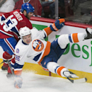 Montreal Canadiens' Mike Weaver, left, collides with New York Islanders' Nikolay Kulemin during first-period NHL hockey game action in Montreal, Saturday, Jan. 17, 2015 The Associated Press