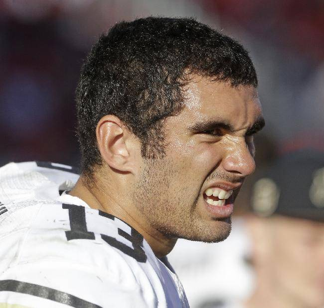 Colorado quarterback Sefo Liufau (13) sits on the sidelines in the second half during an NCAA college football game against Utah, Saturday, Nov. 30, 2013, in Salt Lake City. Utah won 24-17