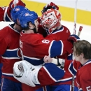 Montreal Canadiens goalie Carey Price (31) is hugged by teammate Brandon Prust (8) after defeating the Ottawa Senators 3-1 in