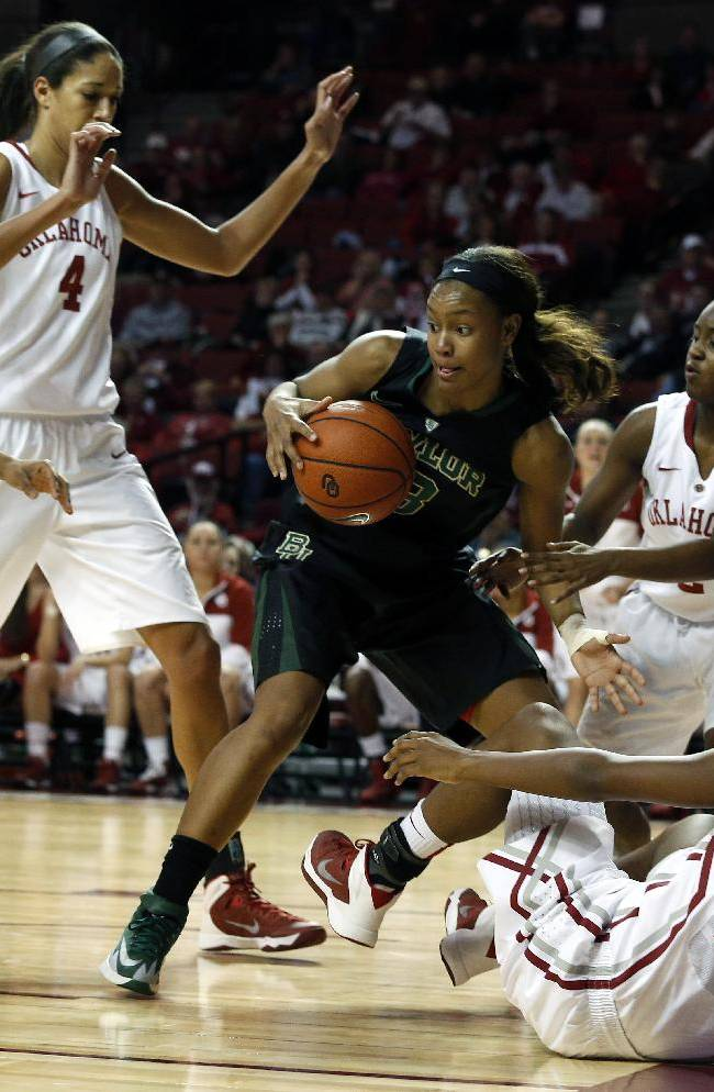 Baylor's Nina Davis (13) gets a the rebound from Oklahoma players during the first half of an NCAA college basketball game in Norman, Okla., Feb. 3, 2014