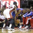 Philadelphia 76ers guard James Anderson, ront right, tries to regain control of the ball as he is guarded by Miami Heat forward James Jones (22) during the first half of an NBA basketball game on Wednesday, April 16, 2014, in Miami. (AP Photo/Wilfredo Lee)