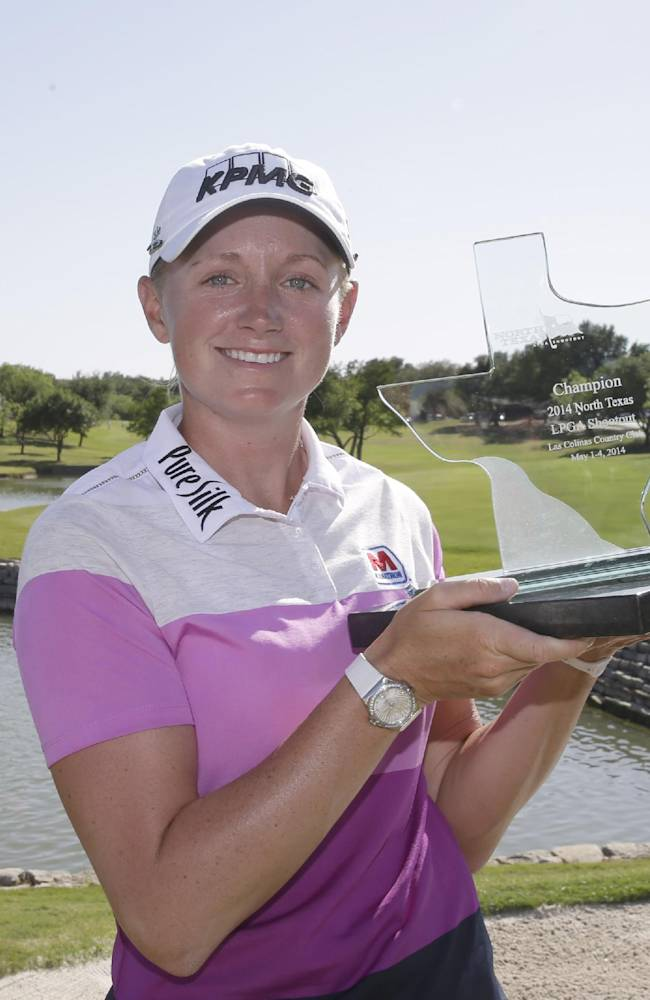 Stacy Lewis posses for a photo with the tourney trophy after winning the North Texas LPGA Shootout golf tournament at the Las Colinas Country Club in Irving, Texas, Sunday, May 4, 2014