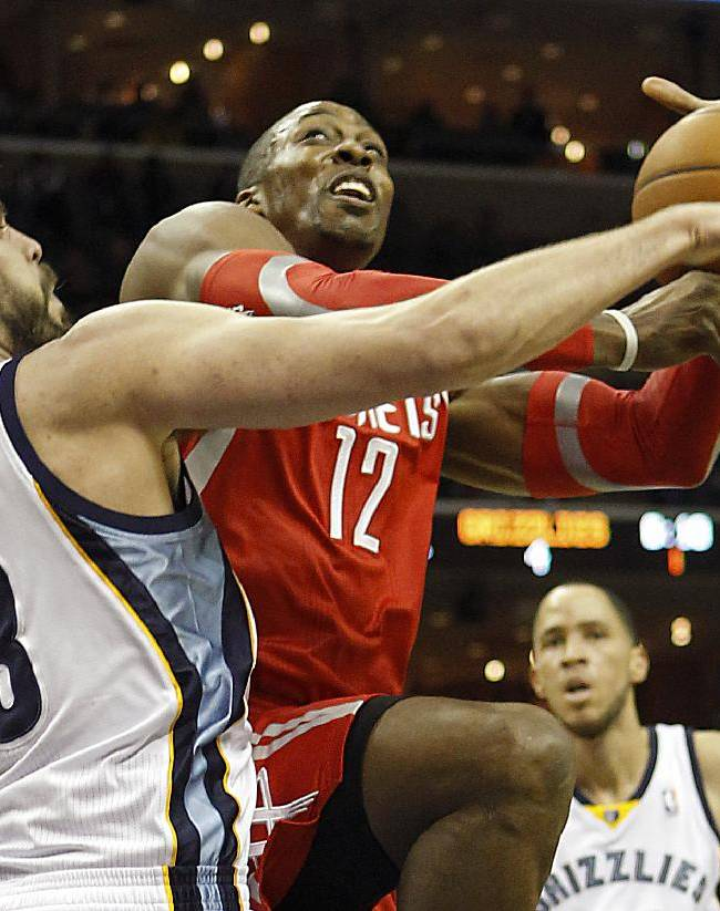 Memphis Grizzlies center Marc Gasol (33), of Spain, fouls Houston Rockets center Dwight Howard (12) in the first half of an NBA basketball game, Saturday, Jan. 25, 2014, in Memphis, Tenn