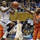 Duke's Chelsea Gray (12) drives to the basket as Clemson's Quinyotta Pettaway, right, defends during the first half of an NCAA college basketball game in Durham, N.C., Thursday, Jan. 10, 2013. (AP Photo/Gerry Broome)