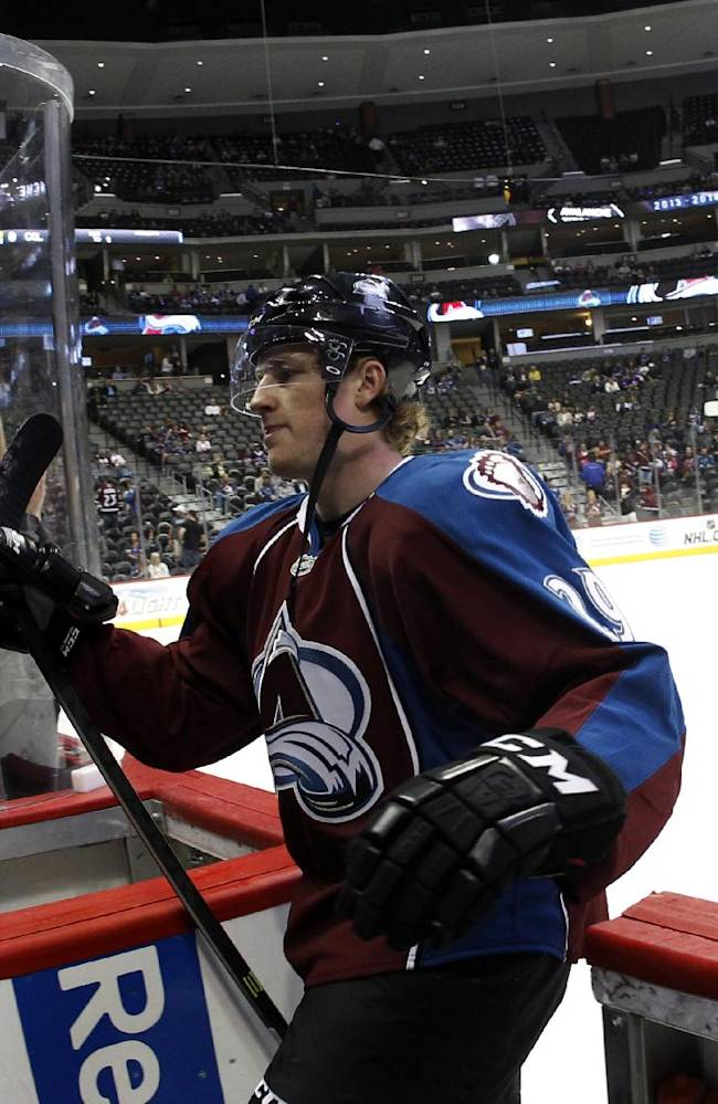 Colorado Avalanche rookie center Nathan MacKinnon glides into the team box after taking part in warmups before facing the Anaheim Ducks in an NHL hockey game in Denver, Wednesday, Oct. 2, 2013