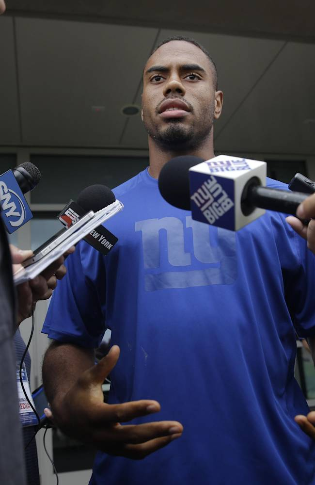 New York Giants' Rashad Jennings talks to reporters during a NFL football camp in East Rutherford, N.J., Thursday, July 24, 2014