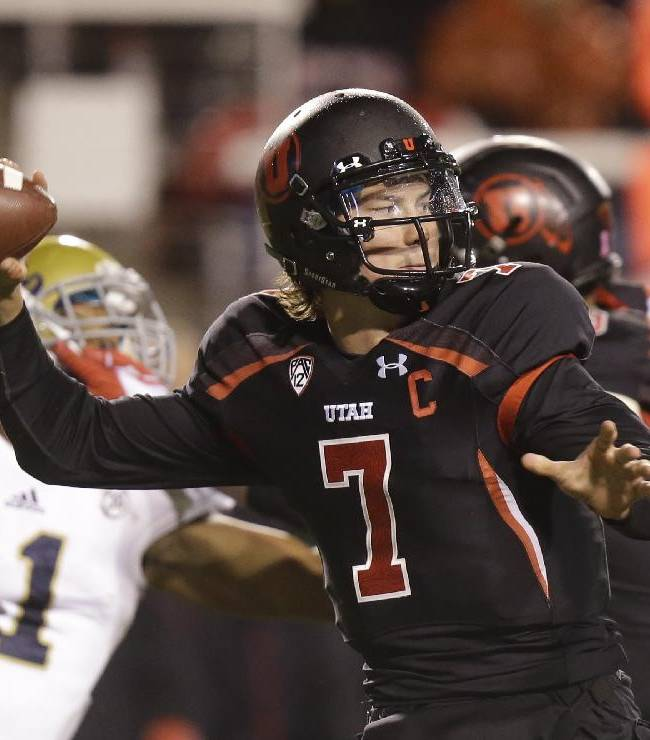 In this Oct. 3, 2013, file photo, Utah quarterback Travis Wilson (7) passes the ball in the fourth quarter during an NCAA college football game against UCLA in Salt Lake City. Idaho State is carrying a 44-game road losing streak into Utah on Thursday night for its season opener. Wilson, who will be playing for the first time since last November when a concussion nearly derailed his career