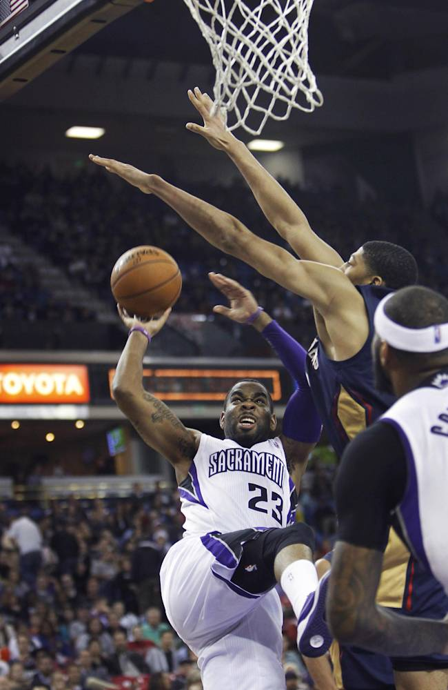 Sacramento Kings guard Marcus Thornton (23) drives to the basket against New Orleans Pelicans defenders during the second half of an NBA basketball game in Sacramento, Calif., on Monday, Dec. 23, 2013. The Pelicans won 113-100
