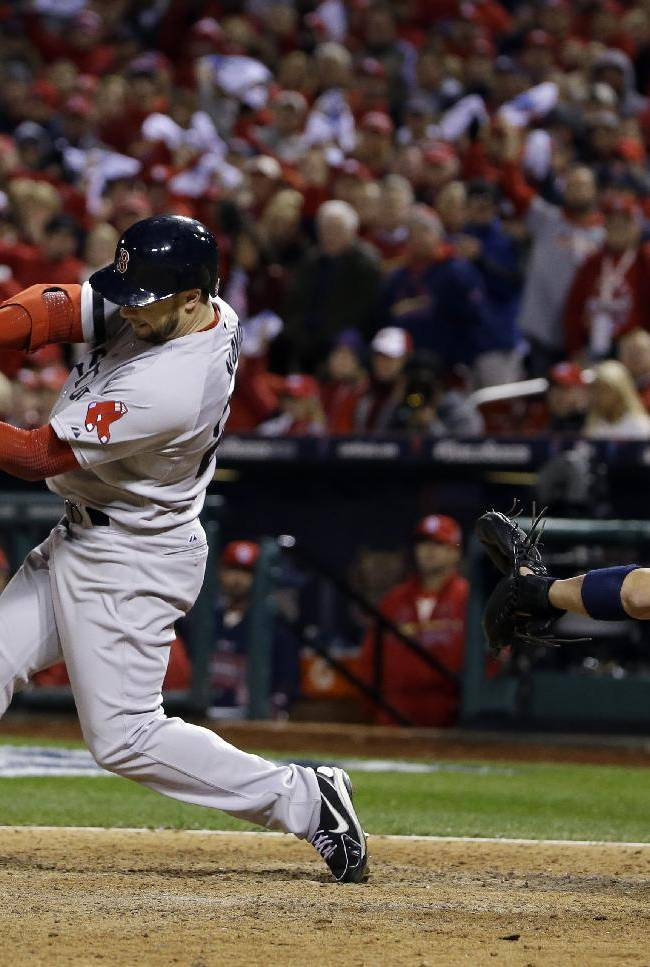 Boston Red Sox's Daniel Nava hits into a fielders choice during the eighth inning of Game 3 of baseball's World Series against the St. Louis Cardinals Saturday, Oct. 26, 2013, in St. Louis. Jacoby Ellsbury scored on the fields choice