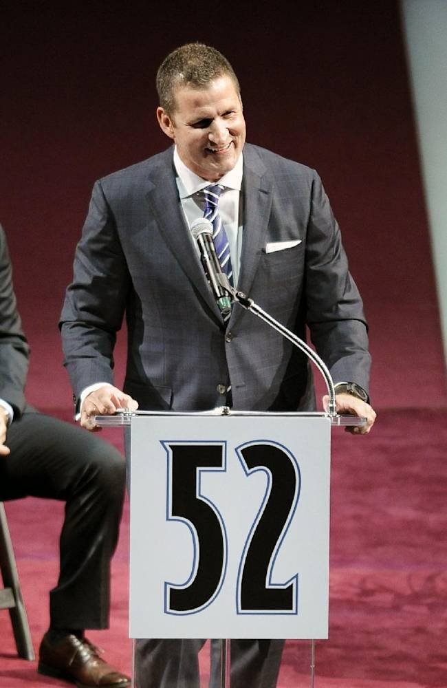 Former Colorado Avalanche defensman Adam Foote speaks at a ceremony to retire his number 52 jersey before an NHL hockey game between the Montreal Canadiens and the Colorado Avalanche on Saturday, Nov. 2, 2013, in Denver. Foote was a member of Colorado's 1996 and 2001 Stanley Cup championship teams