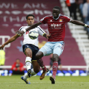 West Ham United's Cheikhou Kouyate, right, competes for the ball with Tottenham Hotspur's Kyle Naughton during their English Premier League soccer match at Upton Park, London, Saturday, Aug. 16, 2014