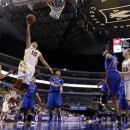 Iowa State' Nicole (Kidd) Blaskowsky (15) shoots against Kansas in the first half of an NCAA college basketball game in the Big 12 women's tournament on Saturday, March 9, 2013, in Dallas. (AP Photo/Tony Gutierrez)