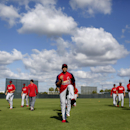 St. Louis Cardinals outfielder Jon Jay is front and center as he warms up with his teammates at the start of spring training baseball practice Tuesday, Feb. 18, 2014, in Jupiter, Fla. Tuesday was the first official day of practice for Cardinals position p